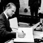 March 21, 1966: Prince Philip signs the guest book at Toronto City Hall