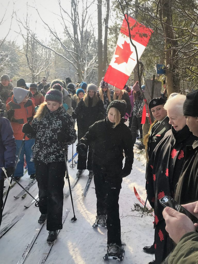 The Lieutenant Governor greets students cross country skiing on the new Canada 150 trail