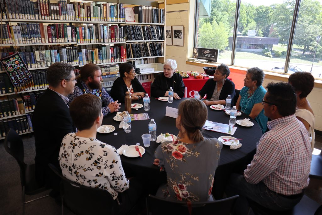 The Lieutenant Governor sits down for lunch with  residential school survivors and supporters of the exhibition Reclaiming Shingwauk Hall at Algoma University