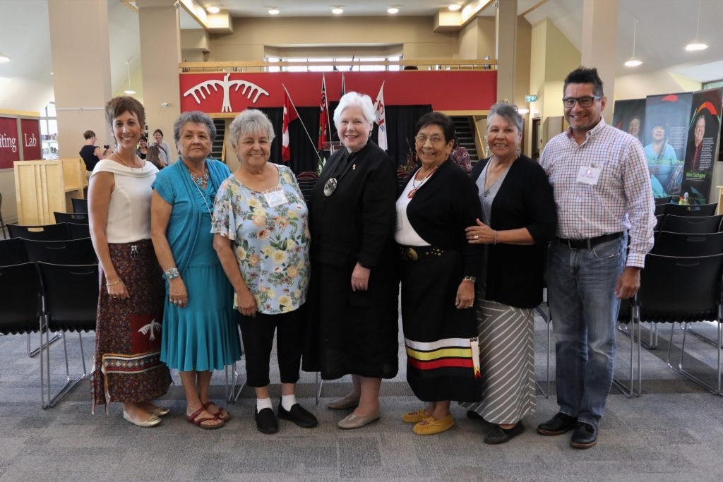 The Lieutenant Governor stands with survivors of Shingwauk Hall Indian Residential School