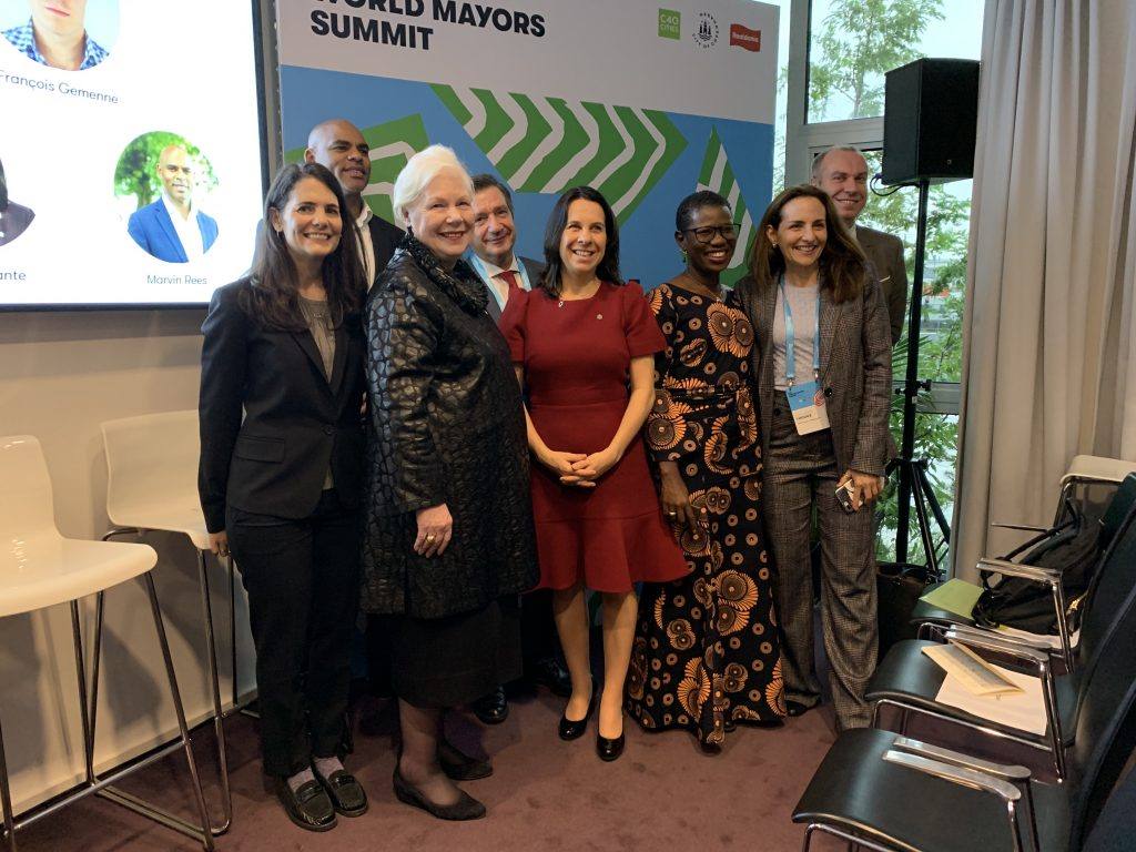 Her Honour with panelists at a migration talk at the World Mayor's Summit