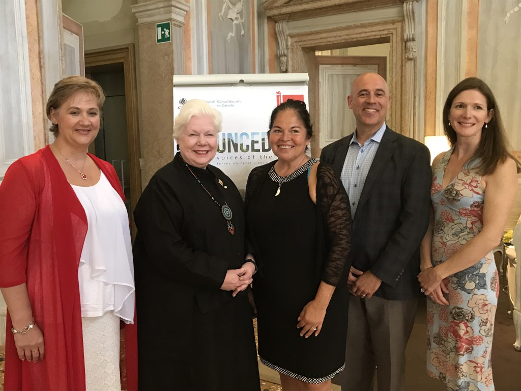 The Lieutenant Governor stands with four Humber College staff in Venice