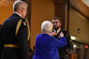 Her Honour pinning Medal for Police Bravery on Constable Jeffrey Lobsinger