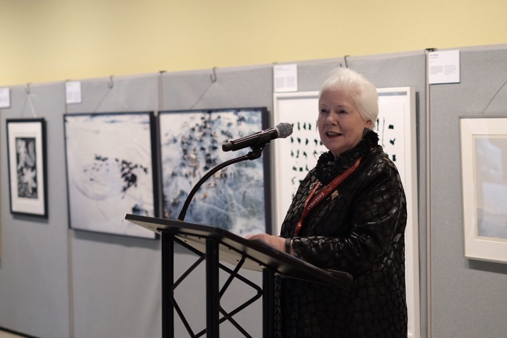 The Lieutenant Governor stands at a podium at the United Nations in New York during the launch of Awakening