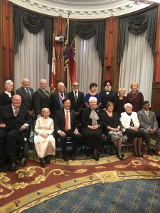 The Lieutenant Governor sits with the recipients of the 2017 Senior Achievement Awards at Queen's Park on November 23, 2018